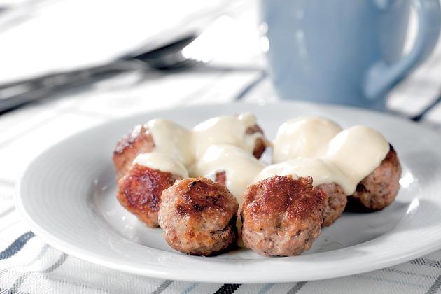 32574_stock-photo-fresh-roasted-meatballs-under-milk-sauce-on-white-plate-closeup-62488693shutterstock_62488693_630x0